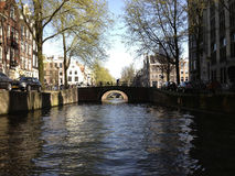 Channel in Amsterdam. Channel with bridges in Amsterdam royalty free stock photography