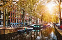 Channel in Amsterdam Netherlands houses river Amstel. Landmark old european city spring landscape Royalty Free Stock Image
