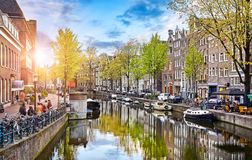 Channel in Amsterdam Netherlands houses river Amstel. Landmark old european city spring landscape Royalty Free Stock Images