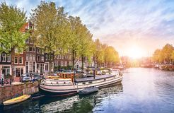 Channel in Amsterdam Netherlands houses river Amstel Stock Photos
