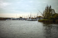 Channel with boat, typical picture of canals in Muiderslot. Royalty Free Stock Image