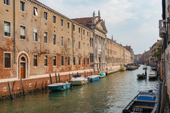 Channel with boats and historic buildings on embankment. Venice, Stock Photography