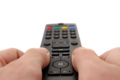 Channel changing. Hands and tv remote control Royalty Free Stock Images