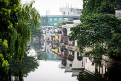 Channel in a Chinese watertown framed by trees Stock Photography