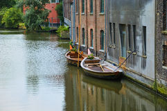Channel in Gent. Belgium with boats reflecting in water Royalty Free Stock Image