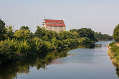 Channel Gliwice. View of the canal Gliwice on the Odra River. In the distance, visible building. On both sides of the river dense vegetation Royalty Free Stock Photo