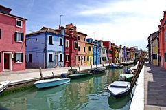 A channel on the island of Burano. A water-channel surrounded by colorful houses in the island of Burano, near Venice, in Italy Stock Image