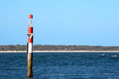 Channel Marker. A red and white channel marker Royalty Free Stock Images