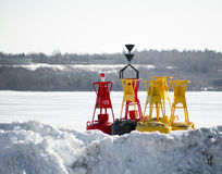 Channel Marker Bouys stored on shore winter Stock Photography