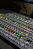 Channel Mixer table. Diagonal shot of TV programme mixer table royalty free illustration