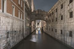 Channel by night in Venice. Empty channel between big buildings by night in Venice, Italy stock photo