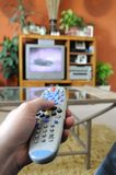 Channel surfing. Lazy afternoon watching TV from the couch Royalty Free Stock Photos