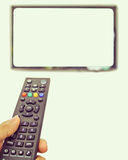 Channel surfing with remote control Stock Image