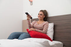 Channel Surfing With Remote Control In Hand Stock Images