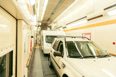 Channel Tunnel train carriage. A car and trailer caravan inside a train carriage of the Channel Tunnel.    The Channel Tunnel is a 23 mile long undersea tunnel Stock Images