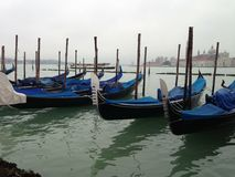 Channel in Venice. Cloudy day in Italy. Island. Boats. Gondolas. Deep water. Adriatic sea Stock Image