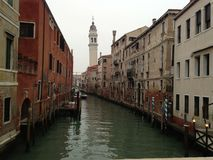 Channel in Venice. Cloudy day in Italy. Old chapel Stock Photography