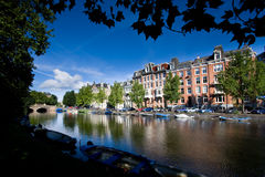 Channel View. Typical houses in amsterdam above a water channel royalty free stock image