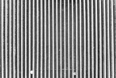 Channeled texture of a water drain lattice Royalty Free Stock Photo