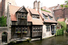 Channels, boat  and houses of Bruges. Stock Photos