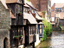 Channels, boat and houses of Bruges. Royalty Free Stock Photo