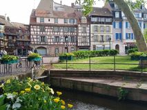 Channels of Colmar, covered with flowers and its colorful old houses. Alsacia, France royalty free stock photo