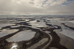 Channels of the Mackenzie River Delta, NWT, Canada. Some of the many channels and ponds of the Mackenzie River Delta during the Spring ice breakup period Royalty Free Stock Photos