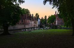 Channels of the old city of Bruges. Belgium. The Belgian Venice. Swans swim through the canals royalty free stock image