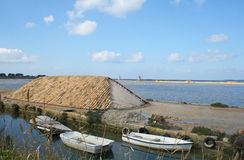 Channels salt flats and mountains of salt. Mozia salt flats in the province of Marsala - Sicily Stock Image