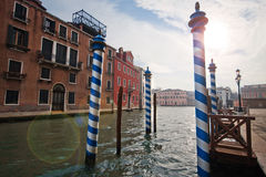Channels and streets of Venice. Gondolas on the canals of Venice. Venetian architecture. Bridges over the canals Stock Photos
