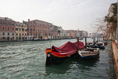 Channels and streets of Venice. Gondolas on the canals of Venice. Venetian architecture. Bridges over the canals Royalty Free Stock Photo