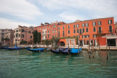 Channels and streets of Venice. Gondolas on the canals of Venice. Venetian architecture. Bridges over the canals Stock Image