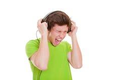 Chant de l'adolescence avec des écouteurs Photographie stock libre de droits