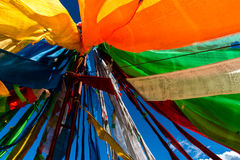 Chant sutras by wind. Scriptures on colorful straps with different meanings Stock Photos