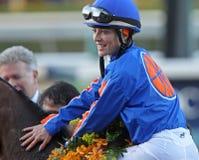 Chantal Sutherland Wins Santa Anita Handicap. ARCADIA, CA - MAR 5: Jockey Chantal Sutherland pats her mount, Game On Dude , after making history as the first Stock Photography