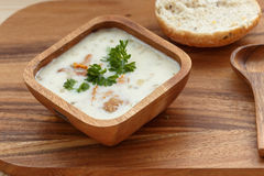 Chanterelle Cream Soup  with fresh herbs. On a wooden background Stock Image