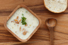 Chanterelle Cream Soup  with fresh herbs. On a wooden background Stock Photo