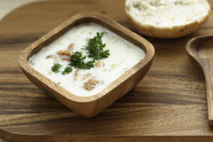 Chanterelle Cream Soup  with fresh herbs. On a wooden background Royalty Free Stock Photo