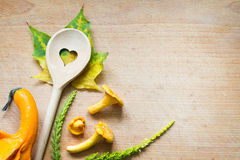 Chanterelle on cutting board food abstract autumn background Royalty Free Stock Images