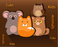 Chanterelle, kitten, owlet and koala. Cubs chanterelle, kitten, owlet and a koala in the group Stock Photo