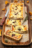Chanterelle mushroom, cheese and thyme quiche Royalty Free Stock Images