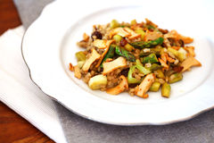 Chanterelle mushrooms and asparagus with barley Stock Photo