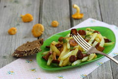Chanterelle mushrooms with potatoes. Fried potatoes with chanterelle mushrooms. Shallow DOF royalty free stock photos