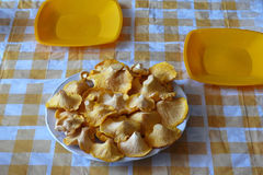Chanterelle mushrooms on a yellow checkered tablecloth Stock Photo