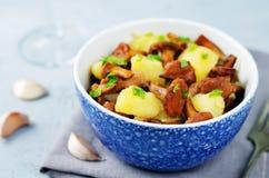 Chanterelle onion fried potatoes Royalty Free Stock Photo