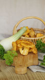 Chanterelle with onion, parsley and basket with mushrooms Royalty Free Stock Photo
