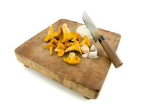 Chanterelles on a cutting board Stock Photo