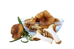 Chanterelles. With green rosemary in glass bowl (cantharellus cibarius Stock Photos