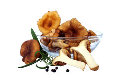 Chanterelles. With green rosemary in glass bowl(cantharellus cibarius Stock Image
