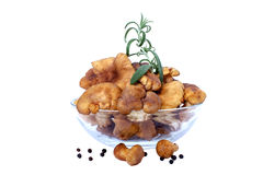 Chanterelles. With green rosemary in glass bowl(cantharellus cibarius Royalty Free Stock Image